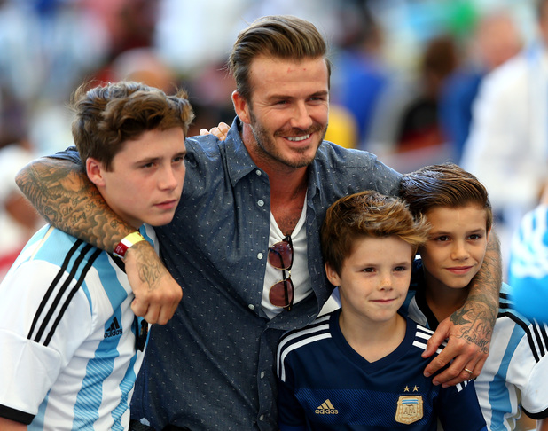 David Beckham and his three sons pose for a picture before the match