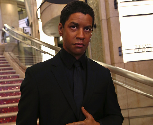 HOLLYWOOD, CA - FEBRUARY 13: A wax figure of actor Denzel Washington from Madame Tussauds Hollywood is seen on the grand staircase to the Dolby Theatre on February 13, 2014 in Hollywood, California. (Photo by David Livingston/Getty Images)