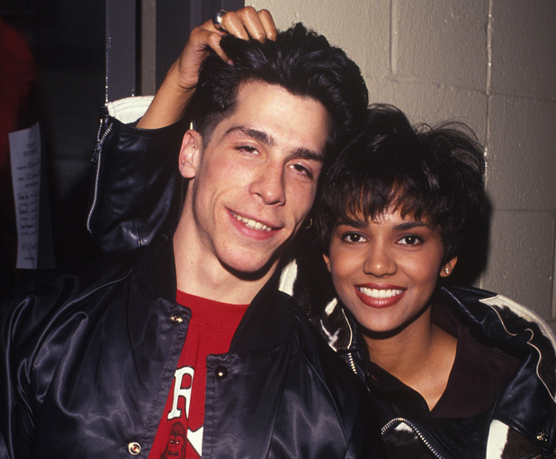 CIRCA 1989: Singer Danny Wood of New Kids On The Block poses with Actress Halle Berry backstage during a circa 1989 concert. (Photo by Larry Busacca/WireImage)