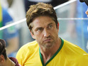 See Gerard Butler supporting Brazil along with Mick Jagger, and more stars.