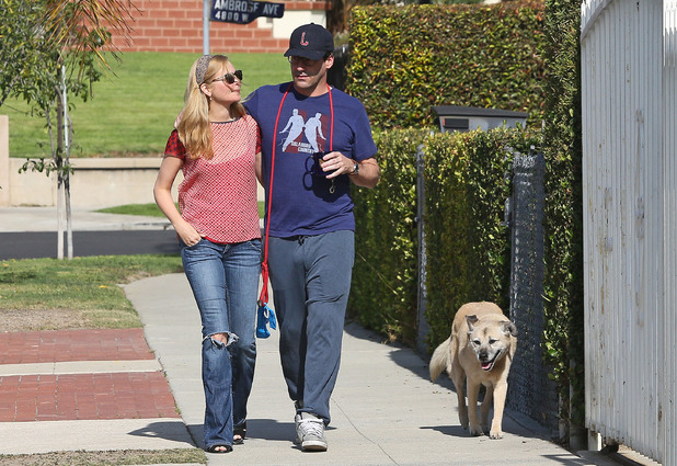 LOS ANGELES, CA - JANUARY 23: Jon Hamm and Jennifer Westfeldt are seen as they take their dog for a walk on January 23, 2014 in Los Angeles, California. (Photo by Bauer-Griffin/GC Images) dog Cora