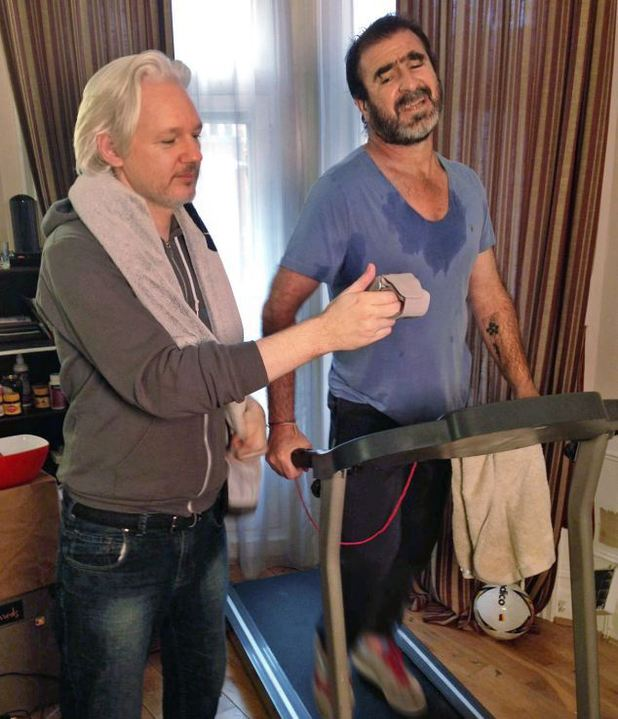 Julian Assange works out with Eric Cantona