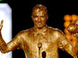Beckham turned gold in awards show sliming