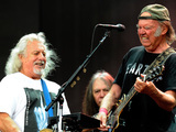 Neil Young performs with Crazy Horse on stage at British Summer Time Festival 2014