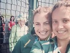 Queen Elizabeth II appears in the background of Australian hockey player's photo.