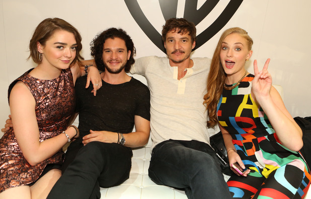 Game of Thrones stars Maisie Williams, Kit Harington, Pedro Pascal and Sophie Turner hang at the Warner Bros. booth at Comic-Con 2014 after their panel