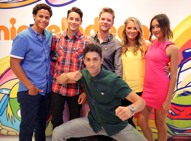 Actors John Mark Loudermilk, Andrew Gray, Cameron Jebo, Ciara Hanna, Christina Masterson and Azim Rizk of Saban's Power Rangers Super Megaforce pose for a photo before their autograph signing at the Nickelodeon booth at San Diego Comic-Con International