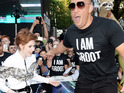 See actor balance on stilts and tower over Karen Gillan at movie premiere.