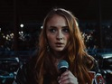 The actress - famous for playing Sansa Stark - performs at a US motor race.