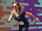 Alesha Dixon tries her luck against Usain Bolt at Commonwealth Games
