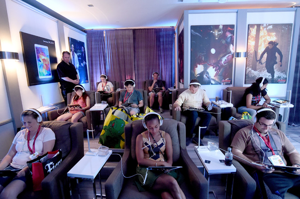 Fans watch clips at Marvel's Avengers: Age Of Ultron Headquarters Powered By Samsung