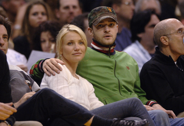 Actress Cameron Diaz and Justin Timberlake watch the Los Angeles Clippers play the Los Angeles Lakers Sunday, April 9, 2006 at a the Staples Center in Los Angeles. (AP Photo/Phil McCarten)