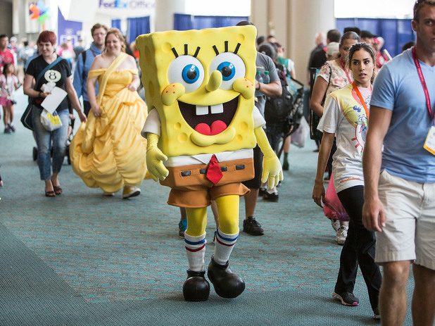 A guest dressed as Spongebob Squarepants wanders through Comic-Con