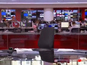 Watch a BBC newsreader climb into shot