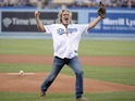 Jeff Bridges pokes fun at his Big Lebowski character at Dodger Stadium.