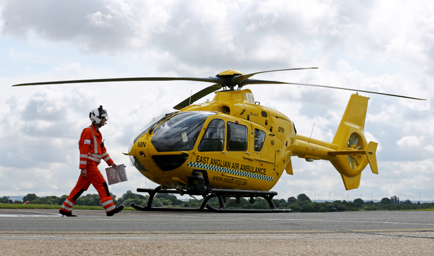 Critical Care Manager Gary Spitzer makes his way towards the East Anglian Air Ambulance at Cambridge Airport