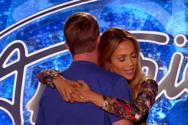 American Idol's Jennifer Lopez dances with contestant