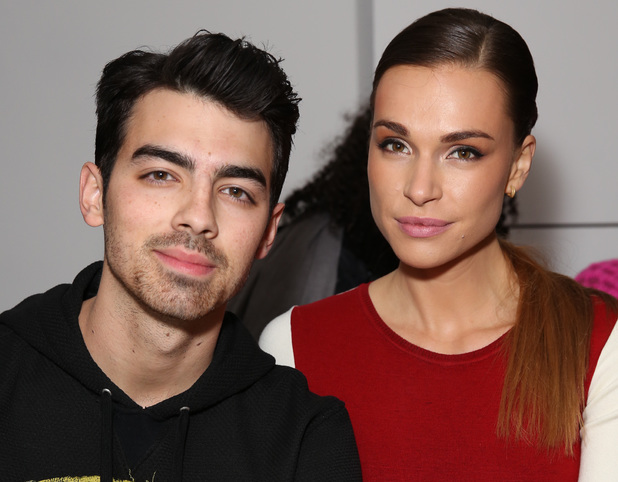 Joe Jonas and Blanda Eggenschwiler attend the The Blonds fashion show during MADE Fashion Week Fall 2014