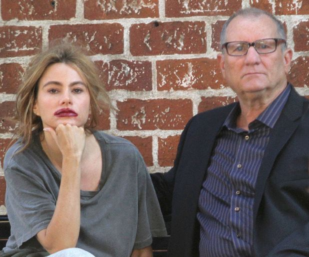 Caption: Sofia Vergara seems to be having a nervous breakdown during a scene for 'Modern Family', shooting with co star Ed O'Neill in Beverly Hills, California.