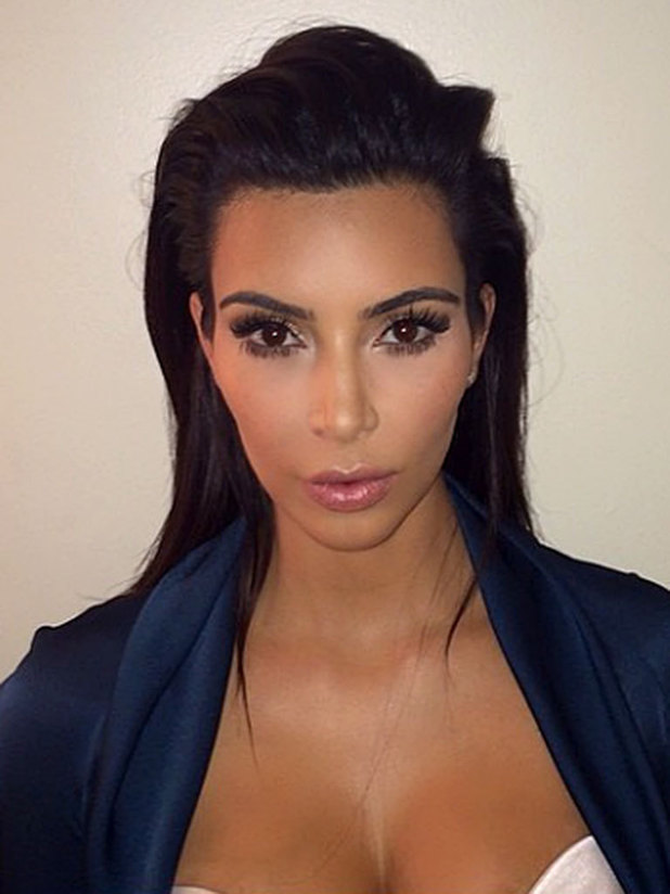 Kim Kardashian legally changes her name to Kim West with passport picture