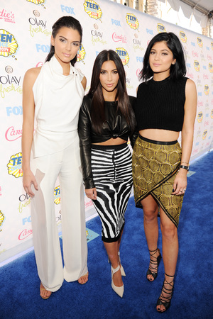 LOS ANGELES, CA - AUGUST 10: (L-R) TV personalities Kendall Jenner, Kim Kardashian, and Kylie Jenner attend FOX's 2014 Teen Choice Awards at The Shrine Auditorium on August 10, 2014 in Los Angeles, California. (Photo by Kevin Mazur/WireImage)