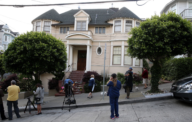 Well wishers and members of the media gather in front of the home where actor and comedian Robin Williams filmed the movie Mrs. Doubtfire