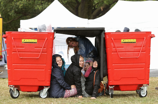 Festival goers sheltering from the rain during day two of the V Festival