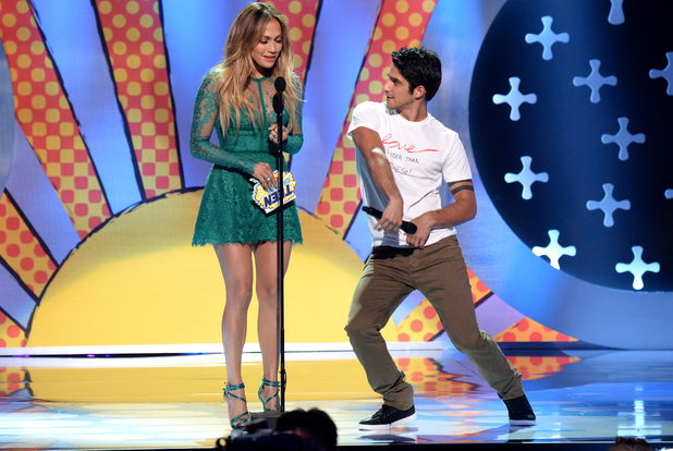 LOS ANGELES, CA - AUGUST 10: Actress-singer Jennifer Lopez and host Tyler Posey speak onstage during FOX's 2014 Teen Choice Awards at The Shrine Auditorium on August 10, 2014 in Los Angeles, California. (Photo by Kevin Mazur/Fox/WireImage)