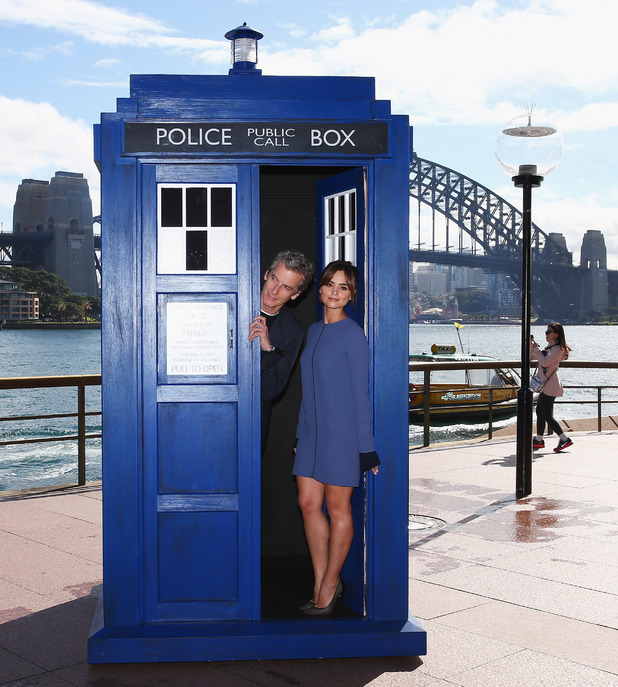 SYDNEY, AUSTRALIA - AUGUST 12: Twelfth Doctor, Peter Capaldi, poses alongside his on-screen companion Jenna Coleman on a world tour to promote the new series of Doctor Who at Dendy Opera Quays on August 12, 2014 in Sydney, Australia. (Photo by Don Arnold/WireImage)