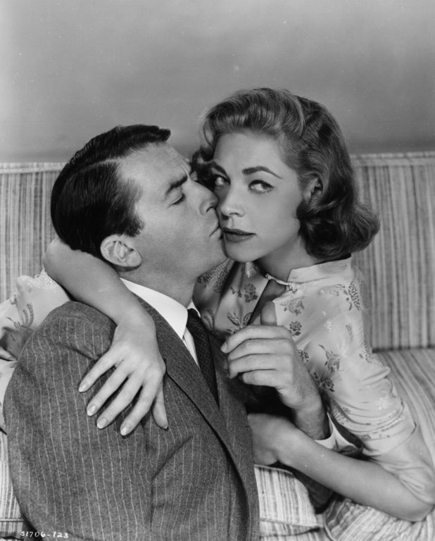 1957: Film stars Gregory Peck (1916 - 2003) and Lauren Bacall in an awkward embrace from the MGM marital comedy 'Designing Woman', directed by Vincente Minnelli. (Photo by Hulton Archive/Getty Images)