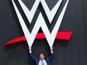 See Vince McMahon unveil new WWE logo