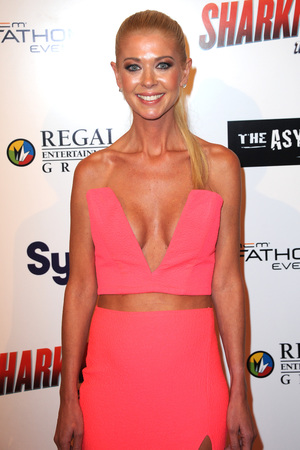 LOS ANGELES, CA - AUGUST 21: Actress Tara Reid arrives for the Premiere Of The Asylum & Fathom Events' 'Sharknado 2: The Second One' held at Regal Cinemas L.A. Live on August 21, 2014 in Los Angeles, California. (Photo by Albert L. Ortega/Getty Images)