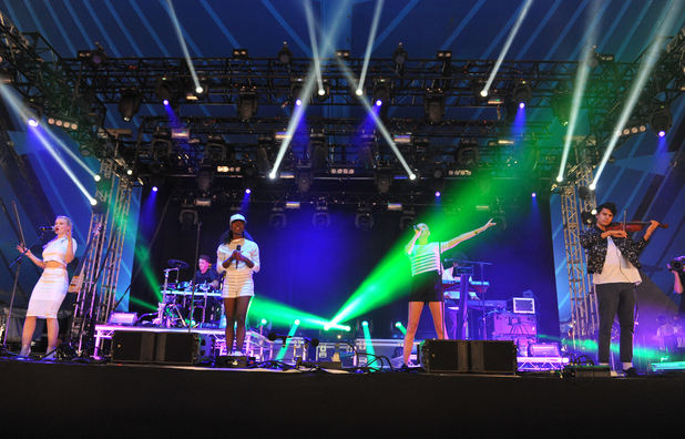 Jack Patterson, Luke Patterson, Grace Chatto, Florence Rawlings, Elisabeth Troy and Milan Neil Amin-Smith of Clean Bandit perform on stage at the Reading Festival