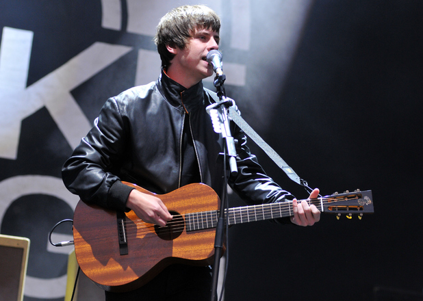 Jake Bugg performs on stage at the Reading Festival at Richfield Avenue on August 23, 2014 in Reading