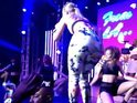 Iggy Azalea falls off stage at MTV VMAs benefit show