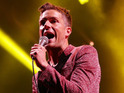 The singer admitted that he was 'frustrated' The Killers aren't as big as U2.