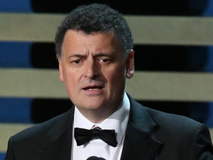 Steven Moffat accepts the Outstanding Writing for a Miniseries, Movie or a Dramatic Special award for Sherlock: His Last Vow on stage during the 66th Annual Primetime Emmy Awards