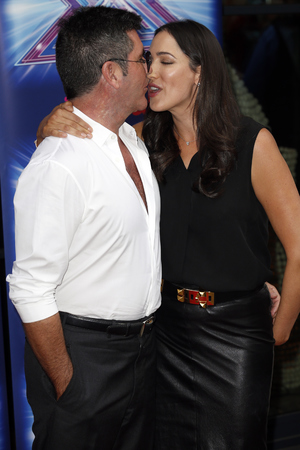LONDON, UNITED KINGDOM - AUGUST 27: Simon Cowell and Lauren Silverman arrive at the Ham Yard Hotel for the launch of the X Factor 2014 on August 27, 2014 in London, England. Photo by Alex Huckle/GC Images)
