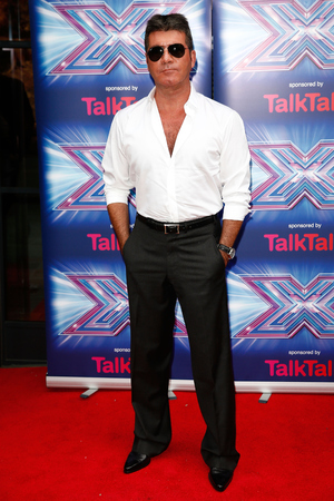 LONDON, ENGLAND - AUGUST 27: Simon Cowell attends the press launch for the new series of 'The X Factor' at Ham Yard Hotel on August 27, 2014 in London, England. (Photo by Tim P. Whitby/Getty Images)