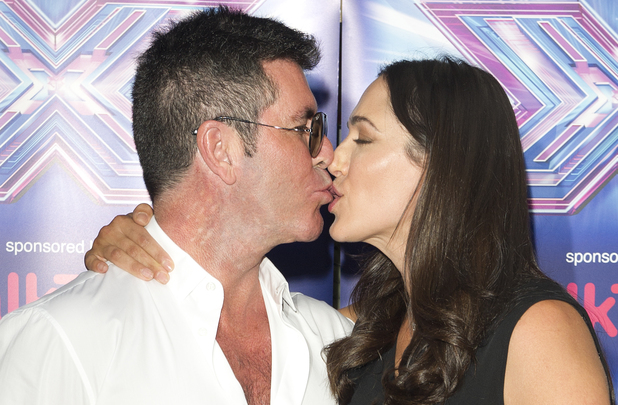 LONDON, UNITED KINGDOM - AUGUST 27: Simon Cowell and Lauren Silverman attends the press launch for the new series of 'The X Factor' at Ham Yard Hotel on August 27, 2014 in London, England. (Photo by Justin Goff/UK Press via Getty Images)