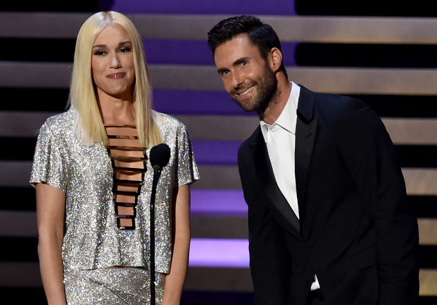 Singer Gwen Stefani and singer/TV personality Adam Levine speak onstage at the 66th Annual Primetime Emmy Awards