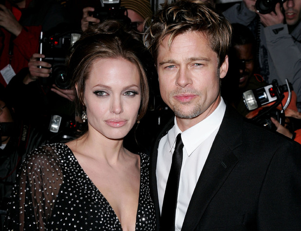 Angelina Jolie and Brad Pitt at the Ziegfeld Theater in New York City, New York (Photo by James Devaney/WireImage)