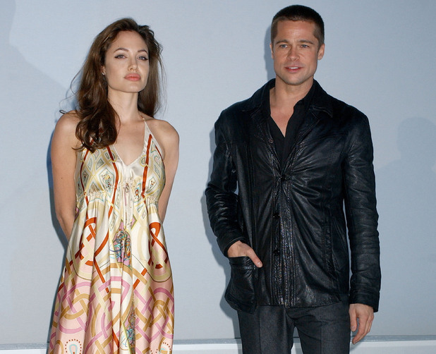 Angelina Jolie and Brad Pitt at the Pairs Hotel in Las Vegas, Nevada (Photo by Gregg DeGuire/WireImage) in 2005
