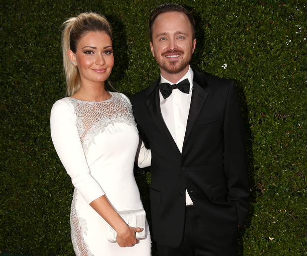 LOS ANGELES, CA - AUGUST 25: 66th ANNUAL PRIMETIME EMMY AWARDS -- Pictured: (l-r) Director/actress Lauren Parsekian and actor Aaron Paul arrive to the 66th Annual Primetime Emmy Awards held at the Nokia Theater on August 25, 2014. (Photo by Christopher Polk/NBC/NBC via Getty Images)