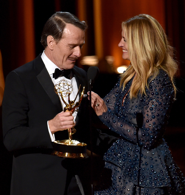 Bryan Cranston accepts Outstanding Lead Actor in a Drama Series for 'Breaking Bad' from actress Julia Roberts onstage at the 66th Annual Primetime Emmy Awards