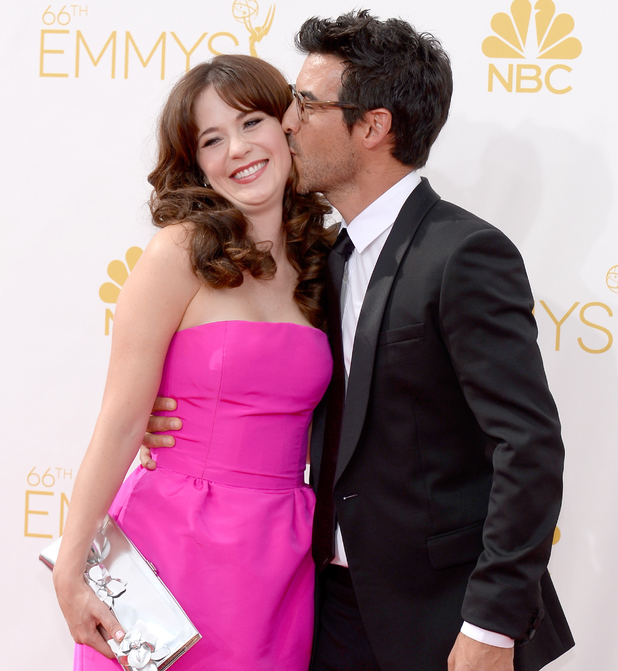 LOS ANGELES, CA - AUGUST 25: 66th ANNUAL PRIMETIME EMMY AWARDS -- Pictured: (l-r) Actress Zooey Deschanel and producer Jacob Pechenik arrive to the 66th Annual Primetime Emmy Awards held at the Nokia Theater on August 25, 2014. (Photo by Kevork Djansezian/NBC/NBC via Getty Images)
