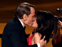 Bryan Cranston gives Julia Louis-Dreyfus a passionate kiss during her Emmy win.