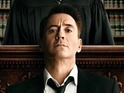 Robert Downey Jr plays it safe in a courtroom drama that's wearingly predictable.