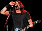 Foo Fighters are heading back out on tour despite Dave Grohl's broken leg