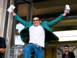 Jamael Ahmed jumps for joy as he leaves the Apple Covent Gardens store becoming the first to purchase the new iPhone 6